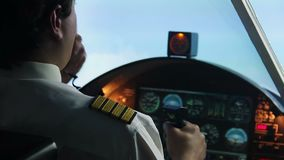 Aviation, pilot operating plane and reporting situation to dispatcher by radio. Stock footage stock footage