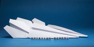 Aviation school concept. Aviation school letters and alphabets on blue background. Conceptual image showing aviation study places royalty free stock image