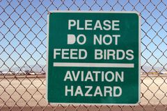Aviation sign. Do not feed birds sign at the airport royalty free stock image