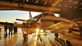 Aviation Sunrise. A beautiful Kansas sunrise with sun rays as seen through a hanger royalty free stock photo
