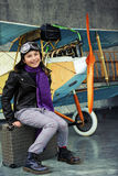 Aviator, happy girl ready to travel with plane. Royalty Free Stock Photos