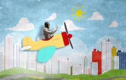 Aviator in retro plane. Mixed media. Funny pilot flying a hand drawn airplane. Mixed media Stock Photos
