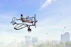 Aviator in retro plane. Mixed media. Funny pilot flying a hand drawn airplane. Mixed media Stock Photo