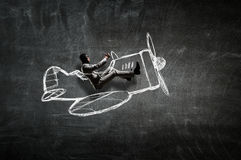 Aviator in retro plane. Mixed media. Funny pilot flying a hand drawn airplane. Mixed media Royalty Free Stock Images