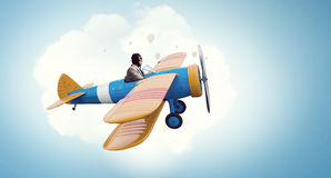 Aviator in retro plane. Mixed media . Mixed media. Funny pilot flying a hand drawn airplane. Mixed media Stock Image