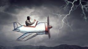 Aviator in retro plane. Mixed media . Mixed media. Funny pilot flying a hand drawn airplane. Mixed media Royalty Free Stock Photos