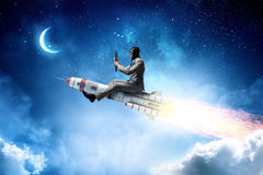 Aviator riding rocket. Mixed media. Man pilot in helmet flying on missile rocket. Mixed media Royalty Free Stock Photo