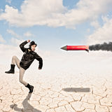 Aviator with a rocket in hot pursuit Royalty Free Stock Photo