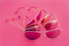 Aviator stile sunglasses on pink background Royalty Free Stock Photography