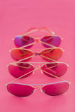 Aviator stile sunglasses on pink background Royalty Free Stock Images