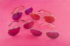 Aviator stile sunglasses on pink background Stock Image