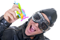 Aviator with toy plane. On white background Stock Image
