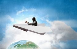 Aviator in paper plane. Mixed media. Aviator wearing old helmet in origami plane. Elements of this image are furnished by NASA Stock Photos