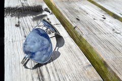 Aviators. Aviator sunglasses with cloud reflections Royalty Free Stock Photo