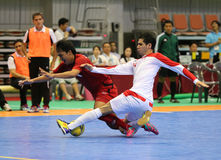 AVID Mahdi of Iran (W) and SORNWICHIAN Jirawat of Thailand fight for the ball. Incheon - July 4:JAVID Mahdi of Iran (W) and SORNWICHIAN Jirawat of Thailand fight Stock Photos