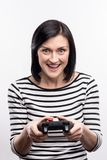 Excited dark-haired woman playing video game royalty free stock image