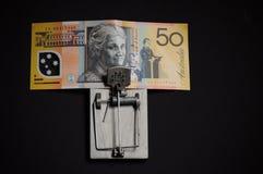 Avidez e australiano financeiro da armadilha da tentação cinqüênta dólares imagem de stock