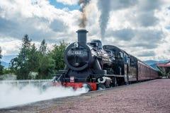 AVIEMORE, BADENOCH and STRATHSPEY/SCOTLAND - AUGUST 24 : Ivatt 4. 6512 Locomotive at Aviemore Station Scotland on August 24, 2015. Unidentified men stock image
