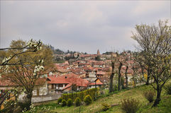 Avigliana landscape in northern Italy. View of Avigliana city from hill in grey spring day Royalty Free Stock Photos