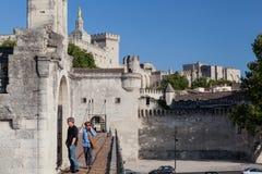 Avignon Bridge Papal Palace France. Tourists on Avignon bridge and the Palais des Papes. Avignon, Provence, France stock photos