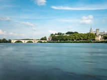 The Avignon bridge and the Papal palace are two touristic attraction built in the medieval time, in Avignon, southern France. The stock photography