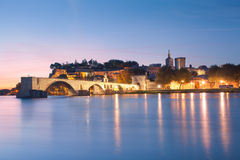 Avignon Bridge with Popes Palace and Rhone river at dawn Stock Photo