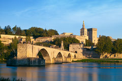 Avignon Bridge with Popes Palace and Rhone river at sunrise Stock Photos