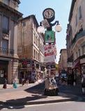 Avignon during the Festival. Avignon, France - July 11th, 2012: Plenty of playbills on the town clock in Avignon during the famous theatre festival Stock Image
