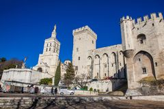 Touristic train at The Papal palace one of the biggest gothic buildings in Europe at Avignon. AVIGNON, FRANCE - MARCH, 2018: Touristic train at The Papal palace royalty free stock photos