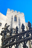 Avignon Palace of the Popes. Metal gate guards entrance to the castle in Avignon, France. Once a fortress and palace, this castle like structure was the papal royalty free stock photography