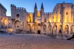 Avignon. Provence. The central facade of the papal palace at dawn. The building of the famous medieval papal palace at dawn. Avignon. France. Provence stock image