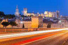 Avignon. Provence. The famous papal palace in the night light. The building of the famous medieval papal palace and the fortress wall at sunset. Avignon. France royalty free stock photo