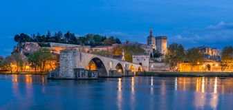 Avignon and it`s famous bridge. Night view of the Pont Saint-Bénezet or Pont d`Avignon in Avignon with Papal palace in the background, France royalty free stock image