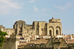 Avignon's Palace of the Popes. The Palace of the Popes rises above Avignon's rooftops Royalty Free Stock Photo