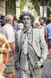 Avignon Theatre Festival. AVIGNON, FRANCE – JULY 19, 2014:  actor, imitating a statue,  in hisc costume in front of the Papal Palace during famous theatre Stock Photos