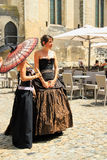 Avignon Theatre Festival. Avignon, FRANCE – July 19, 2014: Two actresses in historical costumes advertising their performance in front of the Papal Palace Royalty Free Stock Photo