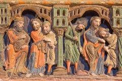 AVILA: Detalj av lättnader från liv av helgon på romanesque polychrome begravnings- minnes- Cenotafio de los Santos Hermanos Mart Royaltyfria Foton