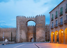Avila - Gate Puerta del Alcazar and the town walls at dusk. Stock Images