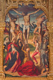 Avila - The painting of The Crucifixion on the main altar of Catedral de Cristo Salvador by Pedro Berruguete 1499. Stock Image