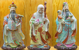 AVILA, SPAIN, APRIL - 18, 2016: The chinese porcelain Famille Rose figure of Fu, Lu, Shou - Prosperity, Happiness, Longevity in co Stock Photography