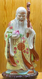 AVILA, SPAIN, APRIL - 18, 2016: The chinese porcelain Famille Rose figure of Tao Lucky Gods Longevity - Shou. In collections of church of Real monasterio de royalty free stock photos