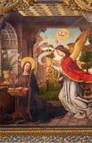 AVILA, SPAIN, APRIL - 18, 2016: Paintig of The Annunciation on the main altar of Catedral de Cristo Salvador by Juan de Borgona Stock Images