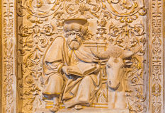 AVILA, SPAIN, APRIL - 18, 2016: The relief of St. Luke the Evangelist in Girola of Catedral de Cristo Salvador.  Royalty Free Stock Photos
