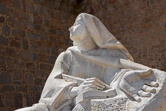 AVILA, SPAIN, APRIL - 18, 2016: The statue of St. Theresia of Avila behind the town walls by Spanish sculptor Juan Luis Vassallo Stock Photography