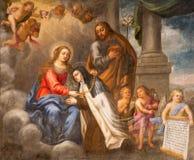 AVILA, SPAIN: St. Theresia of Avila with the Virgin Mary and st. Joseph in church of Real monasterio de Santo Tomas Royalty Free Stock Photo