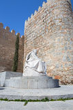 AVILA, SPAIN: The statue of St. Theresia of Avila behind the town walls by the Spanish sculptor Juan Luis Vassallo. AVILA, SPAIN, APRIL - 18, 2016: The statue of Royalty Free Stock Image