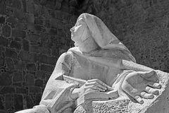 AVILA, SPAIN: The statue of St. Theresia of Avila behind the town walls by the Spanish sculptor Juan Luis Vassallo Stock Photography