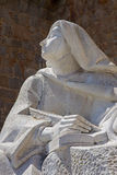 AVILA, SPAIN, 2016: The statue of St. Theresia of Avila behind the town walls by the Spanish sculptor Juan Luis Vassallo Royalty Free Stock Photography