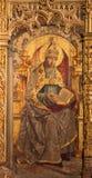 AVILA SPANIEN, APRIL - 18, 2016: Målningen av St Augustine doktorn av kyrkan på det huvudsakliga altaret av Catedral de Cristo Sa Arkivfoton