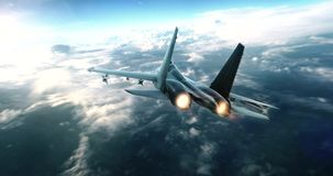 Fighter Jet flying high above the clouds Stock Footage